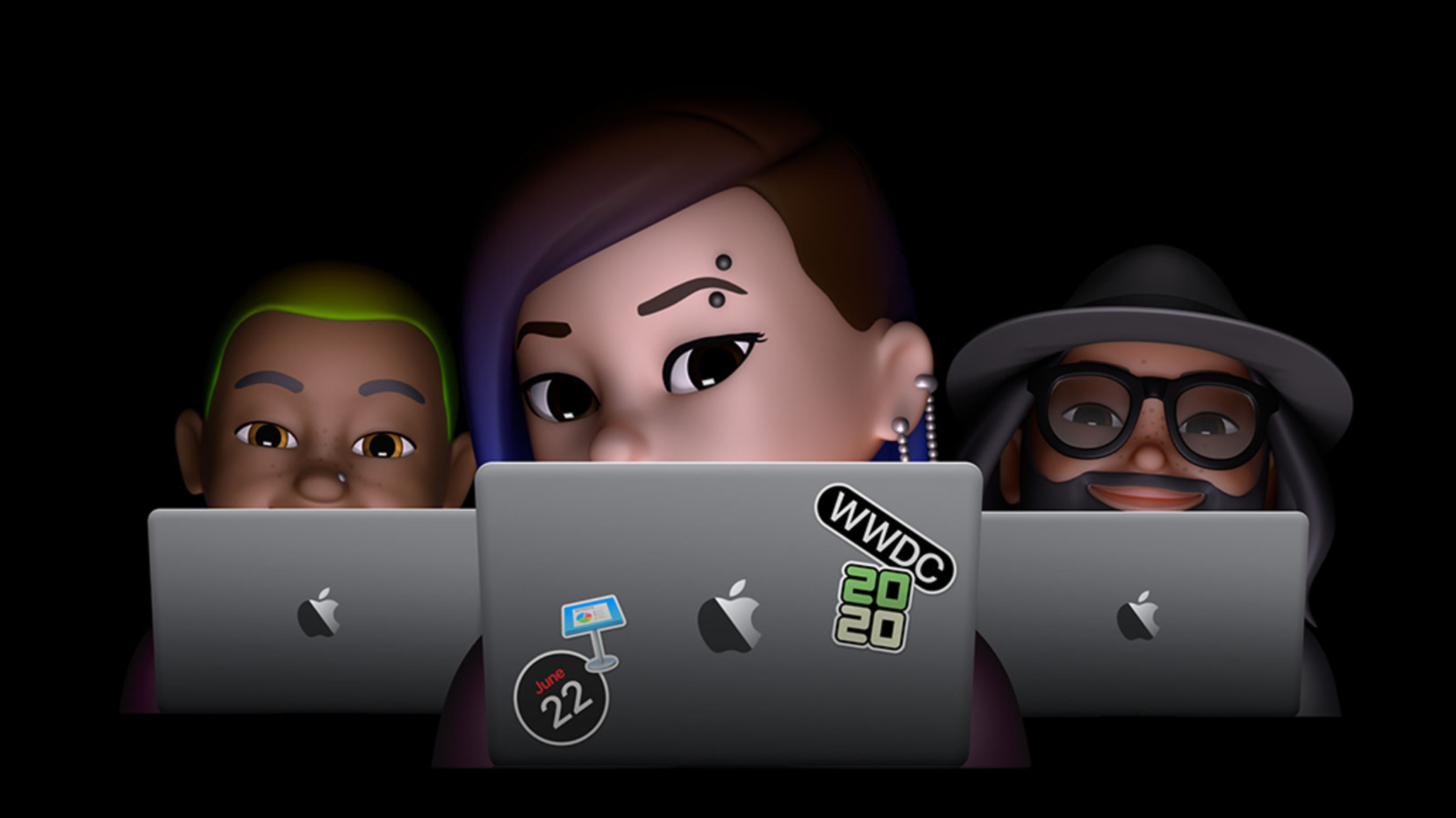 Three Memoji developers sitting behind MacBook Pro