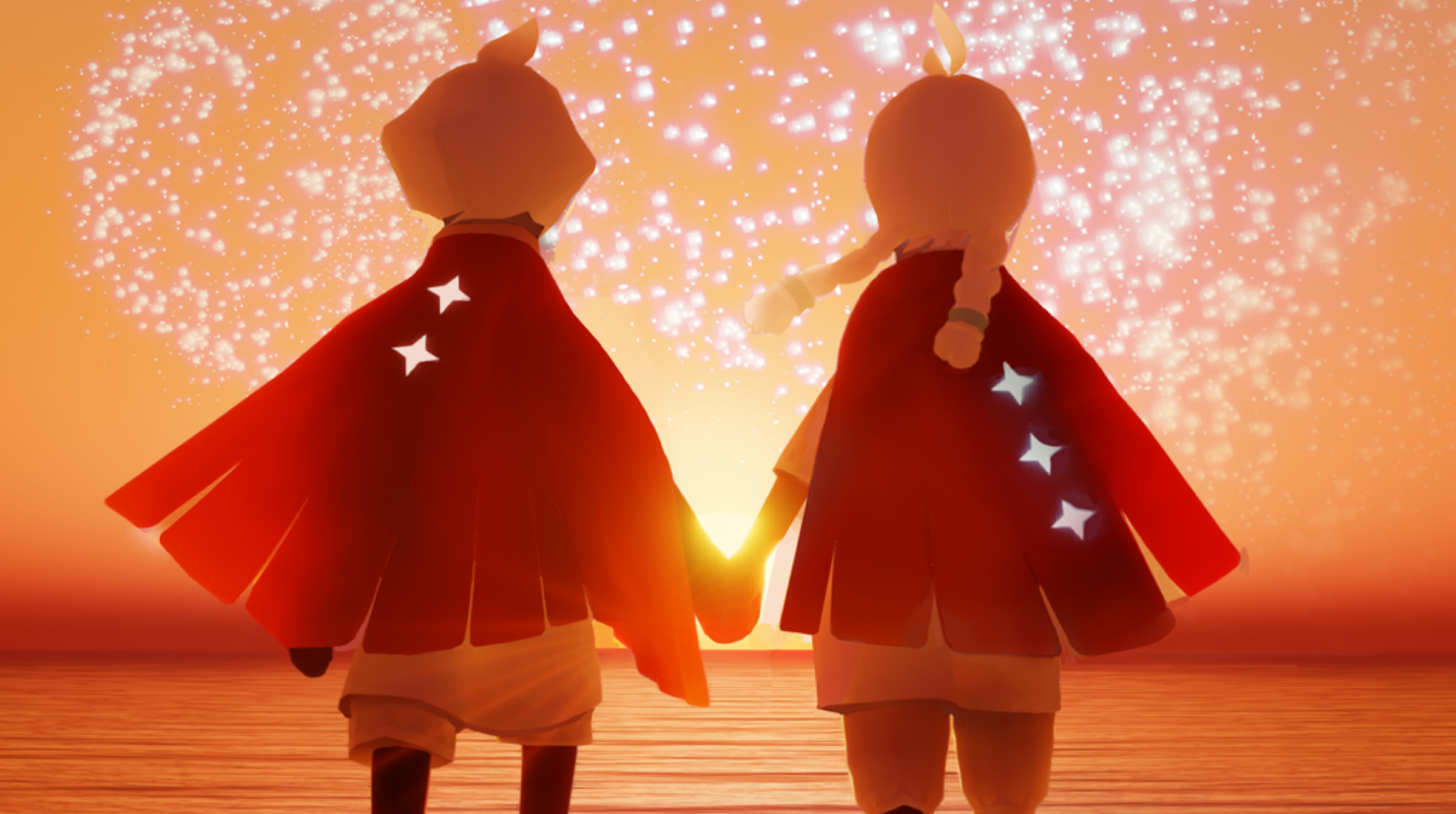 Two protagonists of sky holding hands amidst a sunset