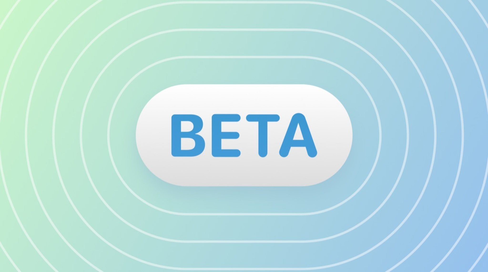 The word beta on a white button with a blue-green background